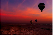 Hot Air Balloon Over Egyptian Valley of The Kings at *Sunset